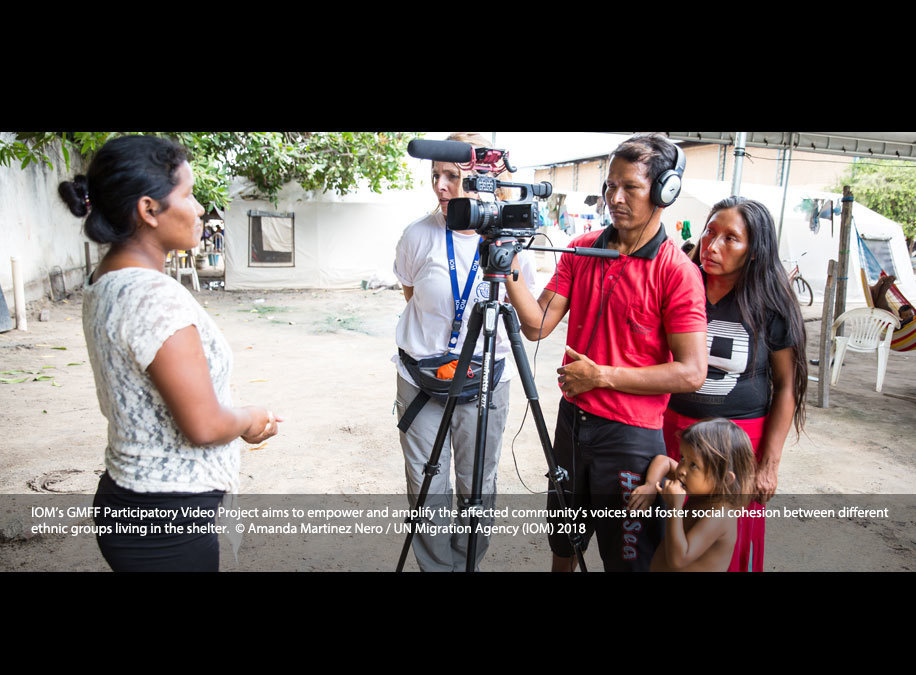 IOM's GMFF Participatory Video Project aims to empower and amplify the affected community's voices and foster social cohesion between different ethnic groups living in the shelter. More than 300 indigenous people of Waro and Eñepas ethnic groups from Venezuela gathered at Pintolandia Shelter in Boa Vista, Brazil. Through games and exercises, participants learned how to use the video equipment and choose the themes they wanted to record.