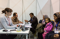 A Syrian family is successfully interviewed by Canadian officials through the help of an IOM interpreter.
