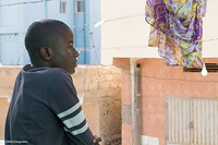 Chris is thirteen years old. He left Liberia because of poverty and Ebola. He saw on the BBC that the trip to the Mediterranean was very dangerous and he did not want to die there. When we started looking for his family, we did not have much more than some incoherent information. Then, thanks to the support of the ICRC, we could contact his grandfather back in Liberia. After sometime, he told us that Chris's mother was still in Mauritania, but in another city. We could find her and Chris's little brother.