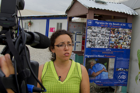 IOM staff being interviewed in Haiti by local media.