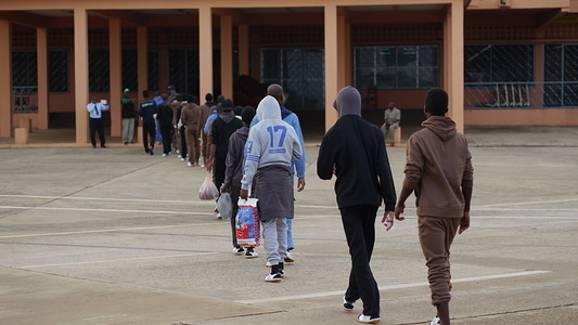 Guinean migrants return home. On 13 June, a special flight chartered by IOM Libya landed at the airport of Conakry-Gbessia, carrying 161 Guinean migrants.  Photo: UN Migration Agency (IOM) / Lucas Chandellier 2017