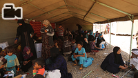 Displaced Iraqis from West Mosul sit under a tent in Hammam Al-Alil town, south east of the city, as they wait for their buses to transport them to other areas (whether camps or liberated areas that can provide shelter to them) after the families are screened by the authorities. Hammam Al-Alil became a transition hub for IDPs in recent months as the Iraqi forces pushed deeper into the West Mosul.