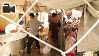 Displaced Iraqis from West Mosul wait in line to receive food in the transition zone of Hammam Al-Alil town, south east of the city. Hammam Al-Alil became a transition hub for IDPs in recent months as the Iraqi forces pushed deeper into the West Mosul. The IDPs arrived in buses, went through screening, and then transported in buses to other areas to provide shelter for them. Some would be sent to camps around Mosul that has room for IDPs, others would be transported to East Mosul that had been liberated and where the IDPs had relatives they could stay with.
