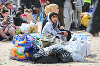 a displaced boy with his family who had just arrived in Hammam Al-Alil transition zone south east of Mosul.