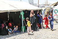 displaced Iraqis from West Mosul wait under a tent in Hammam Al-Alil transition zone, south east of Mosul as they wait for their screening to be completed so they could be transported to camps, or other safer liberated areas in East Mosul.