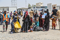 Displaced Iraqis from West Mosul arrive in Hammam Al-Alil transition zone south east of Mosul.