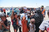 Displaced Iraqis arrive in Hamma Al-Alil transition zone south east of Mosul city.