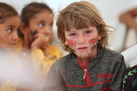 a displaced child with face painting at Haj Ali emergency site. This kid and hundreds of others took part in the Eid festival organized by IOM