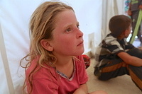 a displaced girl at Haj Ali emergency site