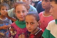 displaced children at Haj Ali emergency site