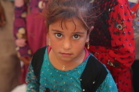 a displaced child at Haj Ali emergency site.