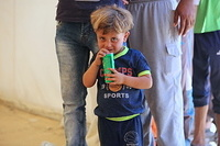 Saad was one of the kids who received clothes and toys. Saad had been separated from his father for 25 months until they finally met again in Haj Ali emergency site.