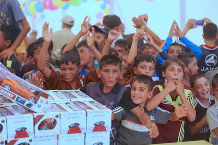 IOM distributed clothes and toys and held an Eid festival for the children at Haj Ali emergency site, south of Mosul, as the Muslim Eid al-Fitr rolled around.