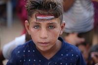 a displaced child at Haj Ali emergency site.