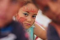 a displaced Iraqi girl during in the Eid Festival organized by IOM in which toys were distributed.