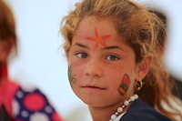 most of the kids had adults paint on their faces as they prepared for the celebrations