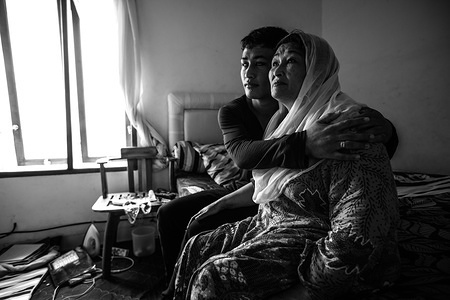 Fatima fled her village in Afghanistan with her disabled son Zabi shortly after the Taliban murdered her husband. Like many ethnic Hazara, the family was routinely discriminated against by elements of the Pashtun-dominated extremist group. Blind since birth, Zabi hopes one day to be able to continue his studies. Refugees in Indonesia, the pair now reside in a small home provided by IOM in the bustling port city in the Province of Sulawesi where they have been awaiting resettlement for years.