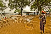South Sudanese Refugee walking near entrance of Pagak Reception Center