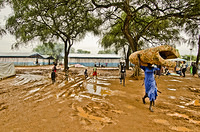 South Sudanese refugee carrying a mattress at Pagak Reception Center.