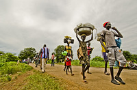 South Sudanese Refugees crossing Pagak border into Ethiopia carrying their belongings.