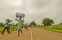 South Sudanese Refugees crossing Pagak border both  into and out of Ethiopia carrying their belongings.
