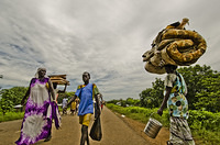 South Sudanese Refugees crossing Pagak border both  into and out Ethiopia carrying their belongings.