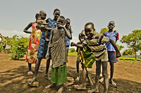 South Sudanese refugee children playfully pose for the camera at Nguenyyiel Refugee Camp.