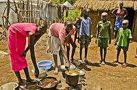 Nyechol preparing lunch for her children at Nguenyyiel Refugee camp.
