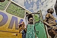 South Sudanese refugee child gets off bus during stop over  from Pagak Reception Center to Metu Way Station. Day one of three-day convoy of South Sudanese refugees from Pagak Reception Center, Gambella Region to Gure-Shembola in Assosa Region.