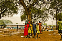 Nedol and her her children pose for the camera at Pagak Reception Center. Nedol and her children are waiting for the three-day convoy transport from Pagak Reception Center in Gambella Region to Gure-Shembola  Refugee Camp in Assosa Region.