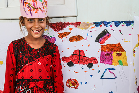 Safaa, 9, has been living in displacement with her family for two years. She is currently living with her family in Chamakor camp for displaced Iraqis, east of Mosul.   She goes to the IOM psychosocial center every day to spend time with other children and engage in recreational activities such as drawing. She drew a house, car, and an Iraqi flag flying on the house.