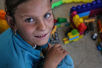 """""""I am in first grade and I love school. I want to become an Arabic teacher when I grow up. I come to this center every day to play with the children,"""" said Wasan, a nine-year-old who lives with her family at Chamakor camp, east of Mosul."""