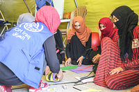 Girls at IOM's psychosocial center in Hassan Sham camp, east of Mosul, are engaged in recreational activities