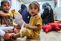 """""""I bring her to IOM's psychosocial centre every day. She likes to spend time here, play with the other children and engage in the activities,"""" said the mother of Hajer, a three-year-old girl.  Hajer's mother, along with other displaced women who come to the center, take part in voluntary puppet-making activities while Hajer plays. The puppets are then given to displaced children."""
