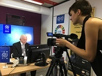 IOM Director General William Lacy Swing is interviewed by staff of IOM's Media and Communications team.