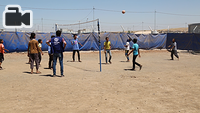 displaced children play volleyball at IOM's Psychosocial Center in Chamakor Camp, east of Mosul.