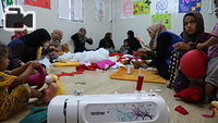 Women at Chamakor Camp for displaced Iraqis, east of Mosul, are engaged in puppet-making activities. The PSS centre organizes recreational activities such as drawing, painting, handcrafts, sports and discussion sessions to help IDP adults and children alleviate stress and reinforce their resilience.