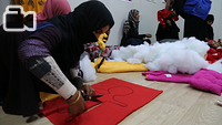 Women at Chamakor Camp for displaced Iraqis, east of Mosul, are engaged in handcrafting activities. The PSS centre organizes recreational activities such as drawing, painting, handcrafts, sports and discussion sessions to help IDP adults and children alleviate stress and reinforce their resilience.