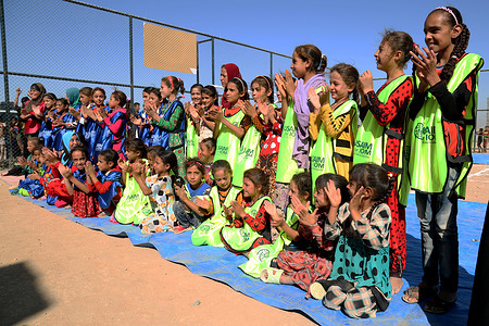 Today these little girls had lots of fun at Haj Ali emergency site's new playground, built with the generous support of the U.S. Association for International Migration. The girls took part in recreational activities that involved teams of two girls each; the girls in each team had one of their legs tied to their partner's, so they had to work in unison to reach the end line. On the way back, they had to carry a potato in a ladle, without dropping it, to complete the circuit.