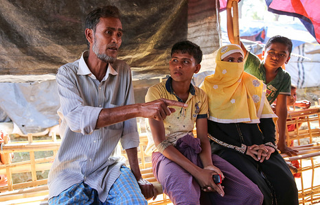 """Caption: At a meeting with IOM in the Balukhali settlement, Khairul Amin passionately relays his message for Pope Francis in anticipation of their meeting later the same week on the Rohingya crisis.   Story: 52-year-old Khairul Amin was very influential in his community in Northern Rakhine State—a well to do jack-of-all-trades with ventures in farming, fishing and retail. """"I even used to have a little shop. Now, I do nothing—just sleeping and eating. I am not in charge of anything more."""" He crossed the border on 5 September but also remembers the massacres of October 2016. His village was heavily targeted at that time and his family suffered greatly. He was even displaced to another village but after a few months he was able to return to his property. When the violence flared up again at the end of August, he could not wait anymore and knew it was time to leave the country to save his, his wife, six children's lives. They all now live close to each other in the overcrowded refugee settlement of Balukhali. He said that he would tell the Pope, """"there is total discrimination"""" in Northern Rakhine State. Having lived through waves of violence and oppression, Khairul Amin said he that's all he would talk about with the Pope. """"Even before, they were oppressing us through extortion but then last year it got violent again."""""""