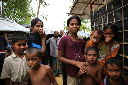 Rohingya refugee children stand outside a shelter in Kutupalong refugee settlement, Cox's Bazar, Bangladesh.