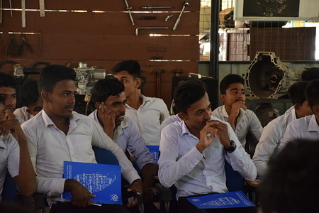 Students with the dockets containing the safe migration information during the safe migration awareness session for the vocational institute students. These students enter the local and foreign job markets after the completion of their vocational courses and industrial placement which make them to opt for migration options.