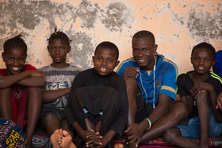 A. K., S., U. et Ad., at the AFCF center at Nouakchott before their return. Lost in Mauritania, a small group of unaccompanied minors returned to their home country 'Sierra Leone'. IOM country offices in Mauritania and Sierra Leone collaborated under a family-tracing program to locate the children's' families whereabouts. After a long journey by plane, by boat and by bus the children were able to rejoin their families accompanied by IOM workers. The IOM officers. Their return was possible thanks to the efforts of diplomats and consulates from the both countries.