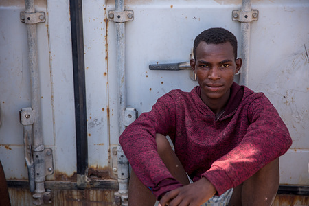 A young migrant in IOM's Migration Response Centre in Obock, Djibouti, where he is staying as he waits for IOM to organize his voluntary return home.  Thousands of migrants from the Horn of Africa travel through Djibouti on their way towards Yemen, usually hoping to reach Saudi Arabia.
