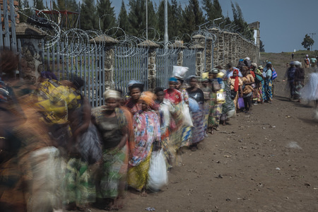 The Petite Barrière Point of Entry screening point is one of two border points connecting the densely populated city of Goma in the Democratic Republic of the Congo with Rwanda. More than 60,000 people cross the Rwanda-DRC border at Petite Barriere each day, mainly for trade and economic activities.   Point of Entry health screening points are located at official border crossings where travellers are monitored for symptoms of the disease and instructed to wash their hands to promote good hygiene and prevent the spread the disease. IOM manages more than 80 screening points in Ebola-affected areas throughout the Democratic Republic of the Congo.