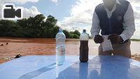 A demonstration of the coagulation effects of Polyglu using river water in Doloow, Somalia.