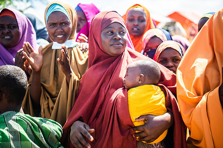 Women IDPs in Marka Town, Lower Shabelle Region listen during community discussion with different UN organizations, IDP